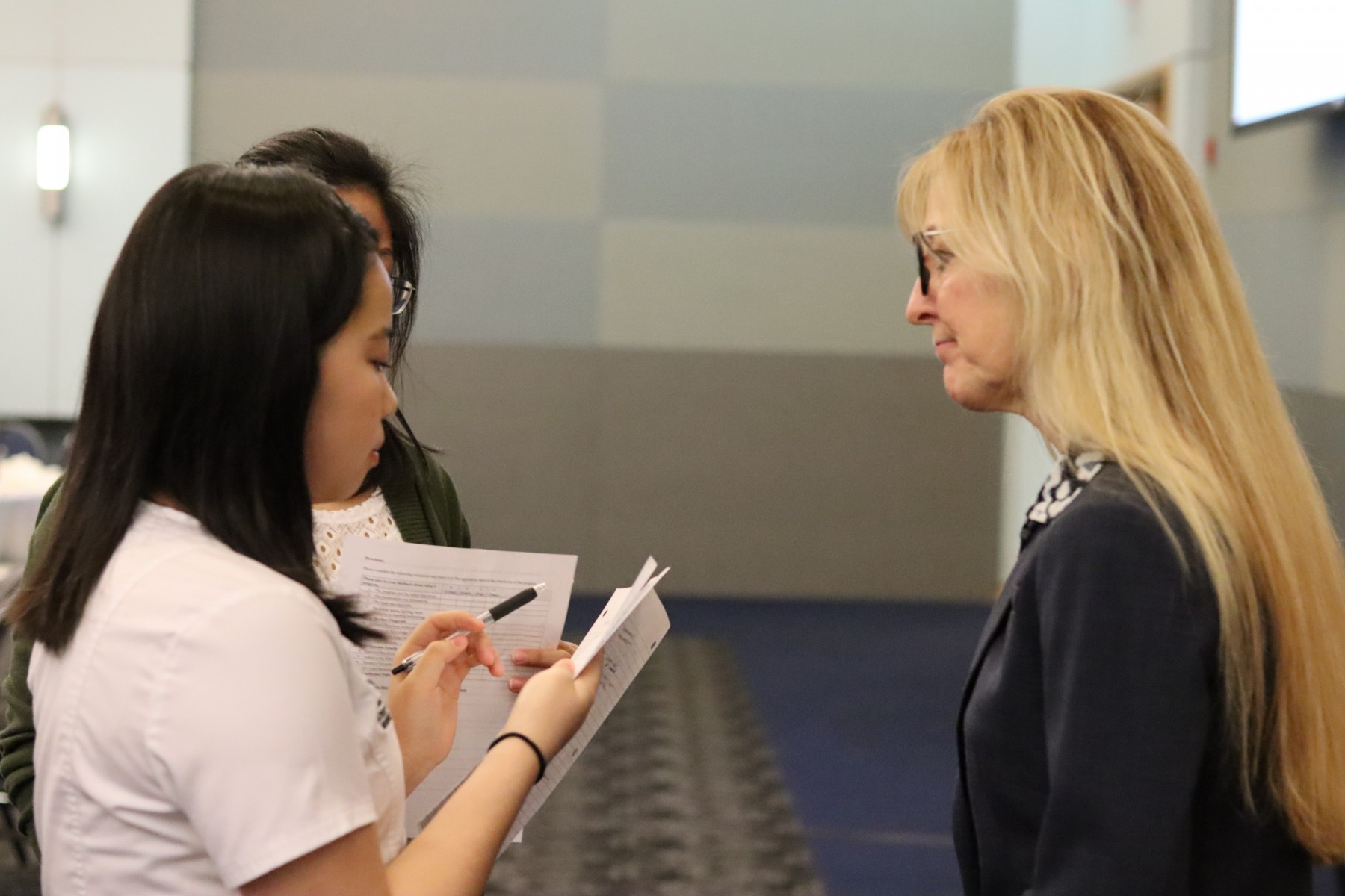 Heather Fitzgerald having a conversation with a nursing student.