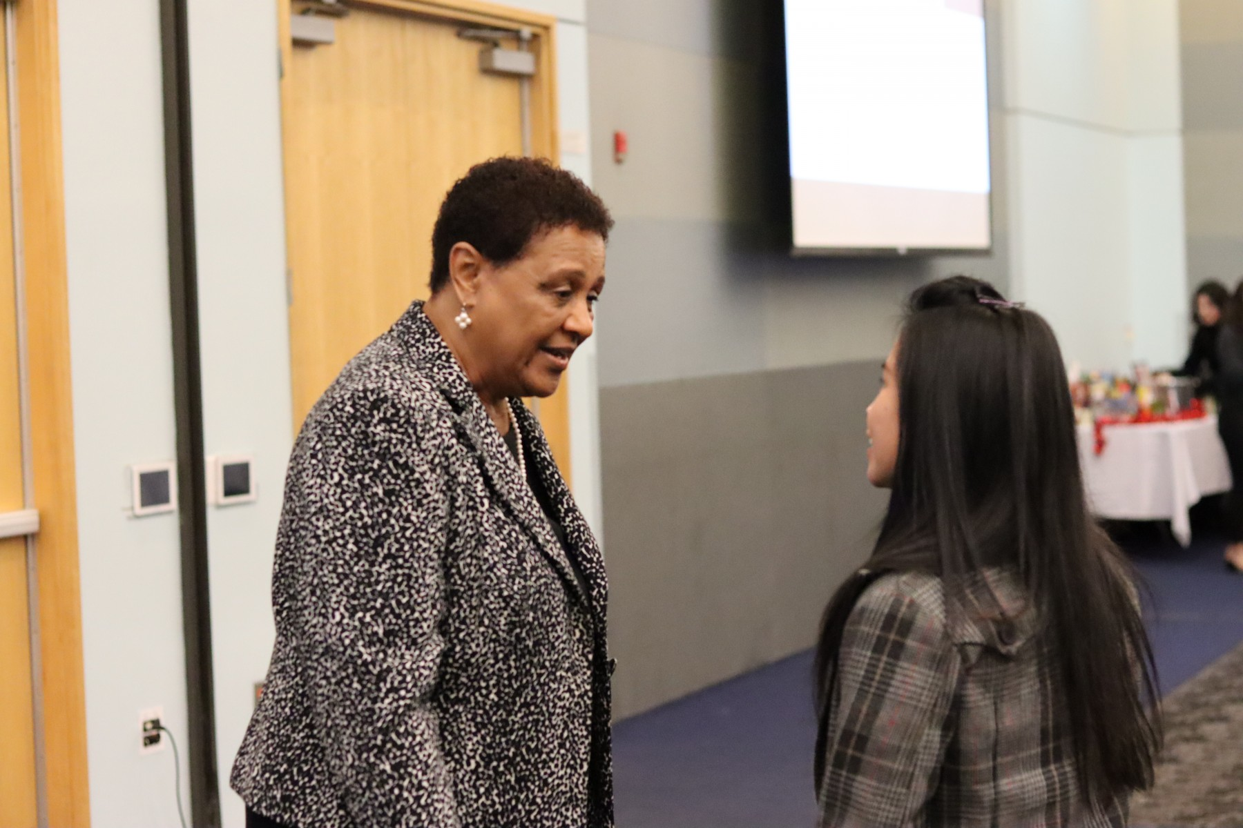 School of Nursing Director, Dr. Gail Washington talking to a nursing student.