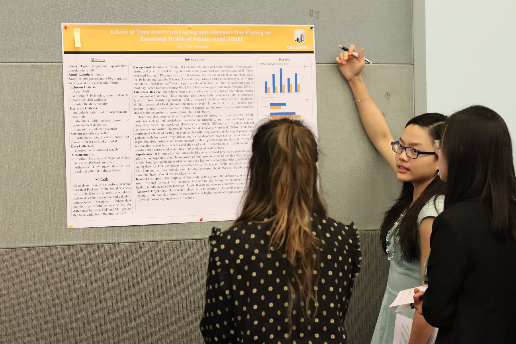 Nursing student showcasing her research project.