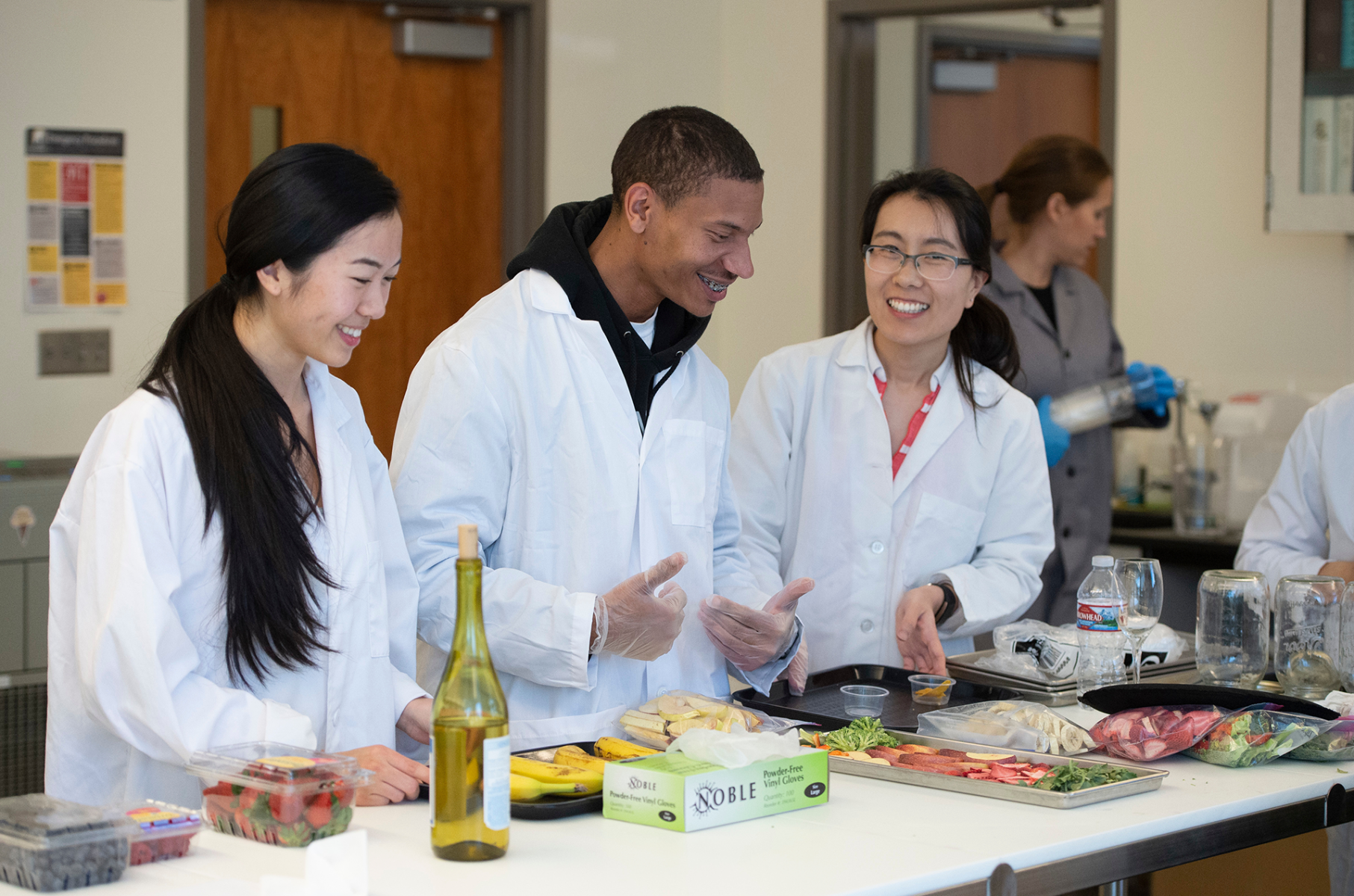Dr. J. Zhao and Students in lab