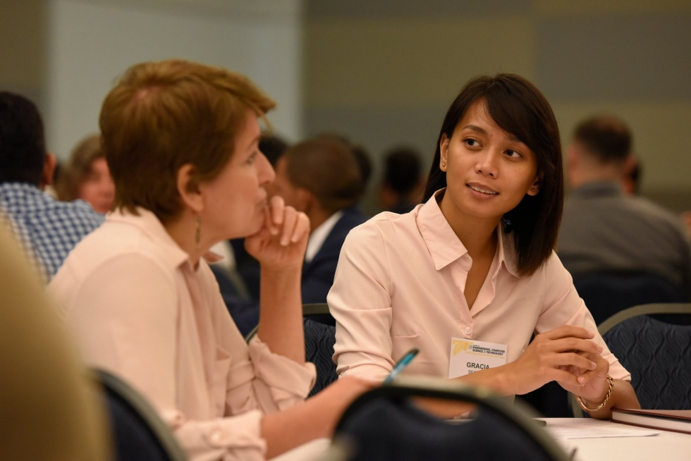 Female student engaged in conversation at Capstone Senior Design Launch 2018-19