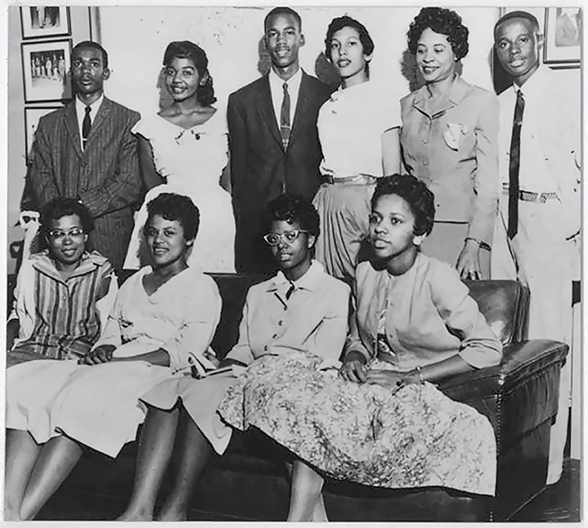 The Little Rock Nine and the National Association for the Advancement of Colored People's Daisy Bates. Terrence Roberts is standing, third from the left. (Photo courtesy Library of Congress/NAACP)