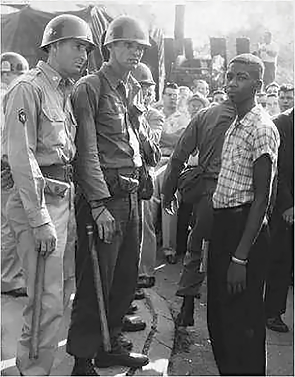 A 15-year-old Terrence Roberts is turned away from Central High School by members of the National Guard. (Photo courtesy Central High School Museum Historical Collections/UALR Archives)