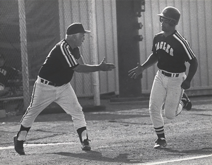 John Herbold, left cheers on a player after a homerun versus Montclair State in this archive photo from 1990.