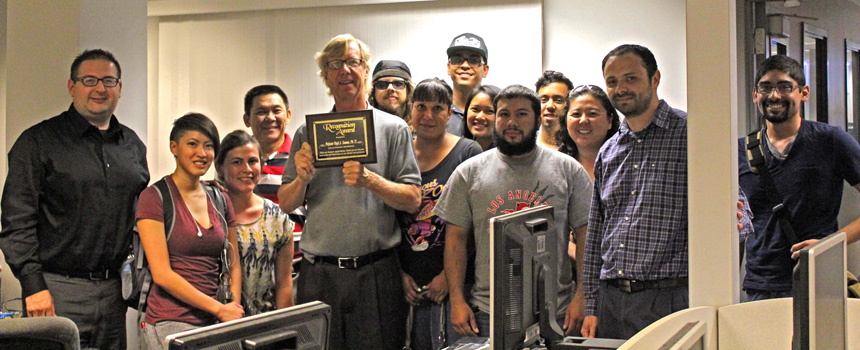 Dr. Virgil Seaman presented a recognition award by his students