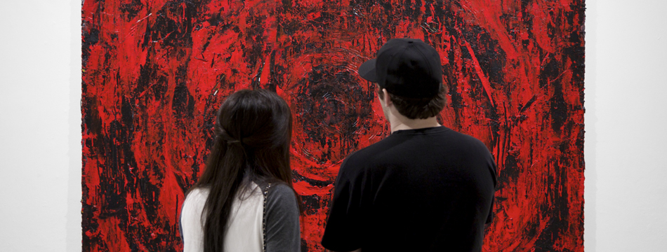 People looking at an art gallery