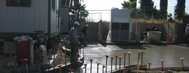 Workers next to fresh cement