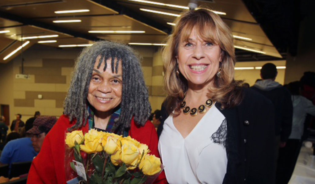 Sonia Sanchez with Dr. Lauri Ramey, professor in the English Department and director of the poetry center