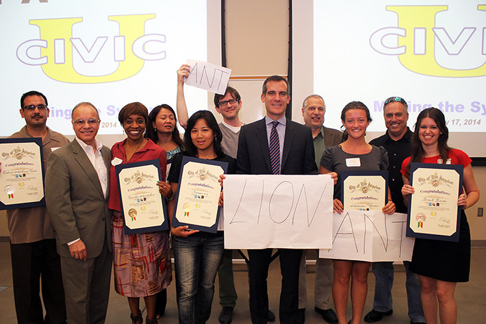 Mayor Eric Garcetti and President William A. Covino serve as the mock city council for class presentations at Civic University.