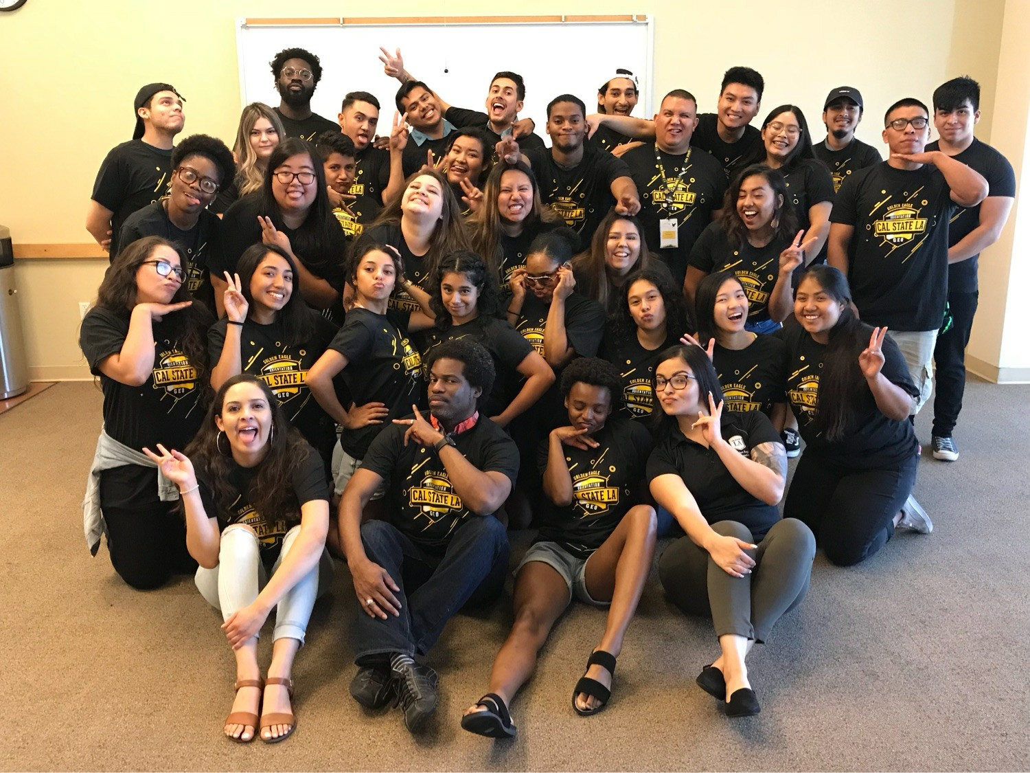 Silly photo of the summer 2018 Orientation Leader team with full time staff