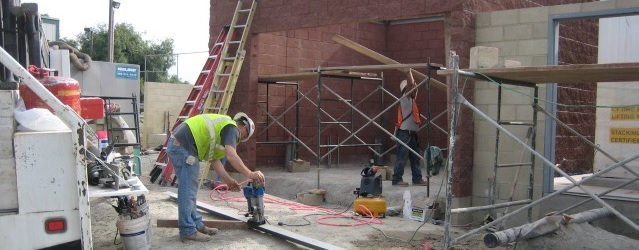 Construction workers building the control room