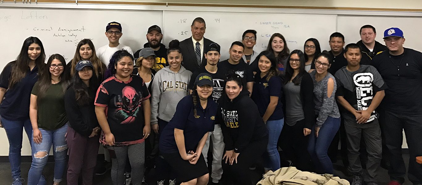 Twenty-three undergraduate students with Judge Lofton during an Alpha Phi Sigma Honor Society meeting.
