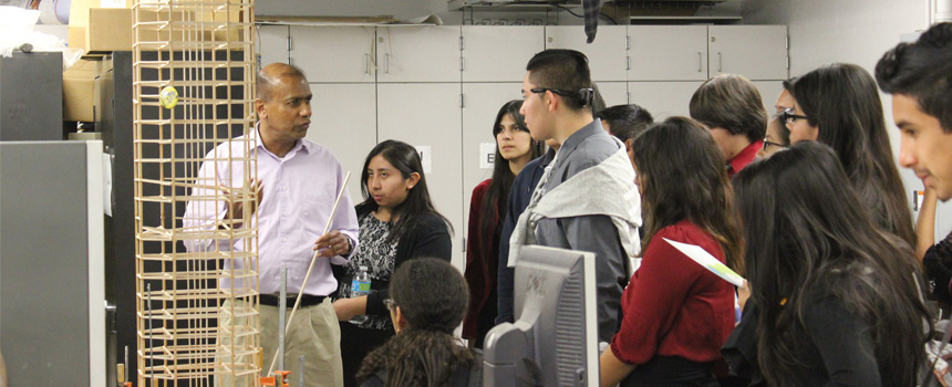 Dr. Rupa Purasinghe giving a tour of the Strengths of Material lab to students