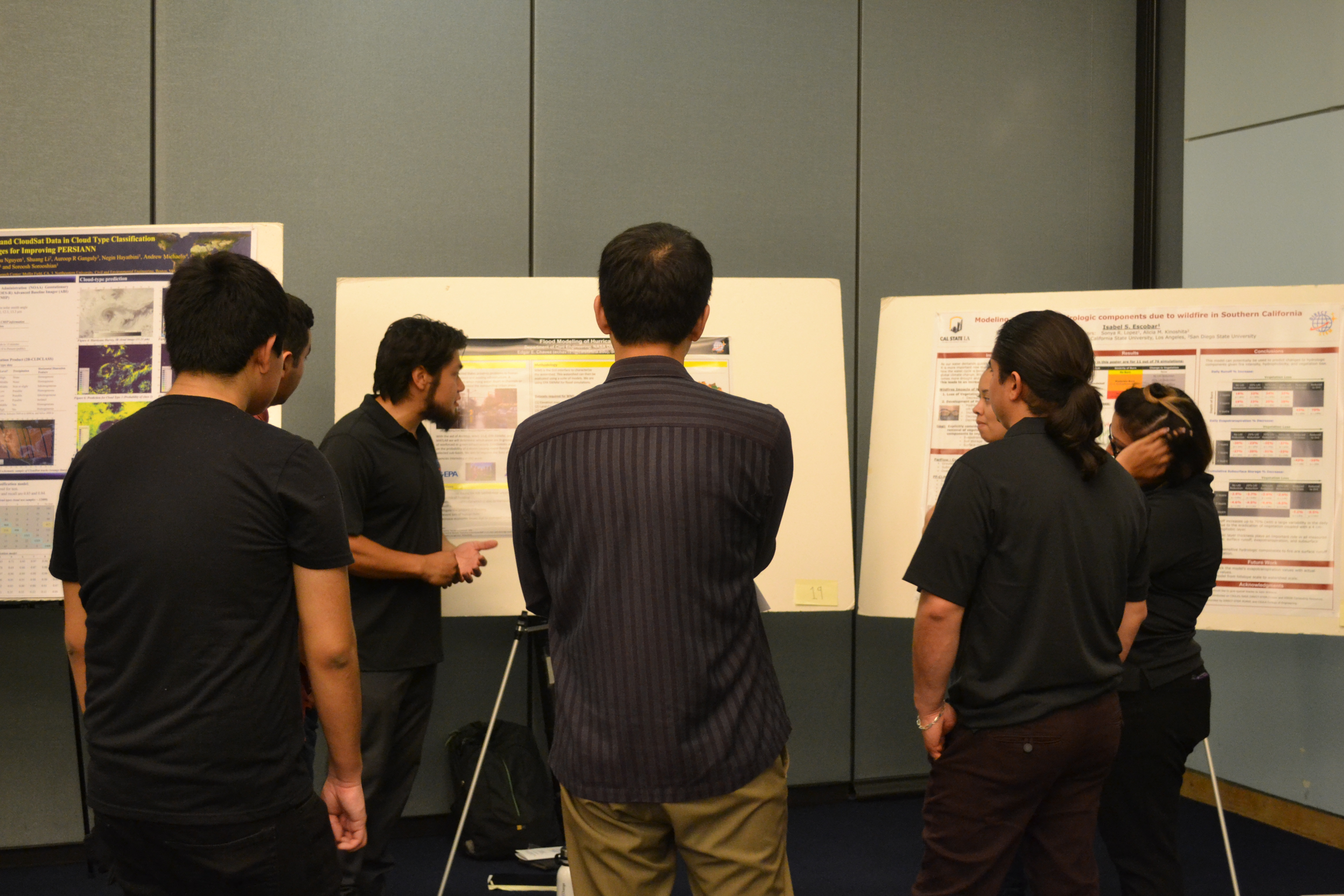 Edgar Chavez explaining his research poster at the 4th Annual NASA DIRECT-STEM Research Symposium