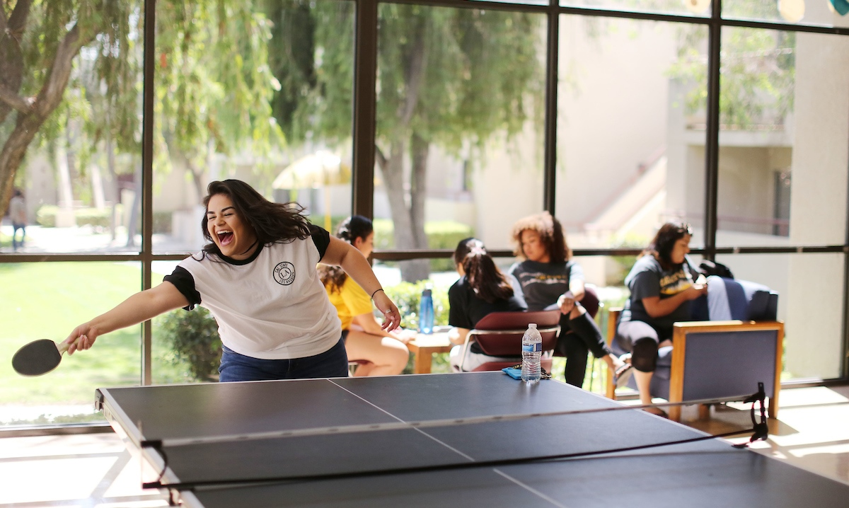 Female resident playing pingpong.