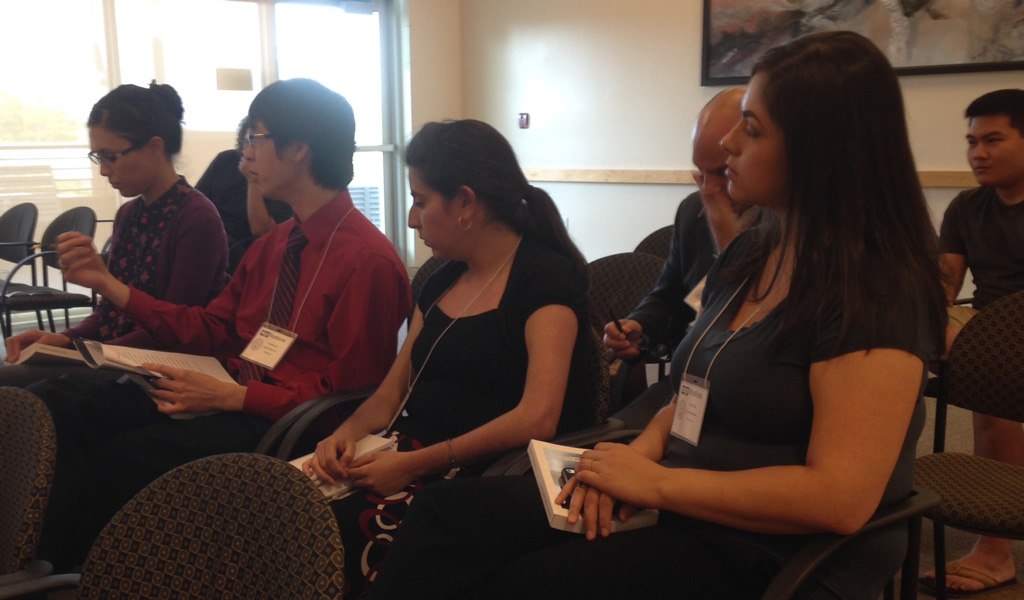 Jonathan Lee asks a question while Emily Yasonia, Christina Mills, and Carol Bryan listen