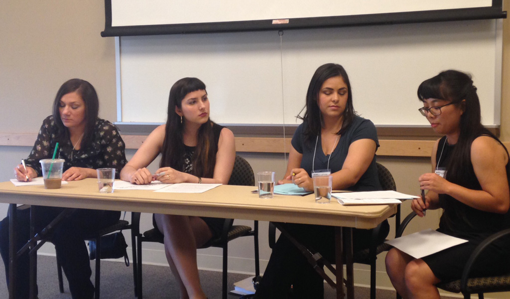 Nicole Arslan, Lauren Mendoza, and Carol Bryan listen as Amanda Kong presents her paper at Significations 2014