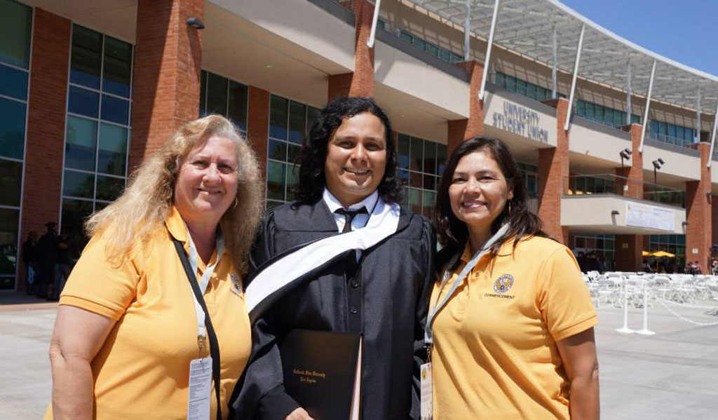 Jeanne Gee and Yolanda Galvan with graduate Joey Reyes