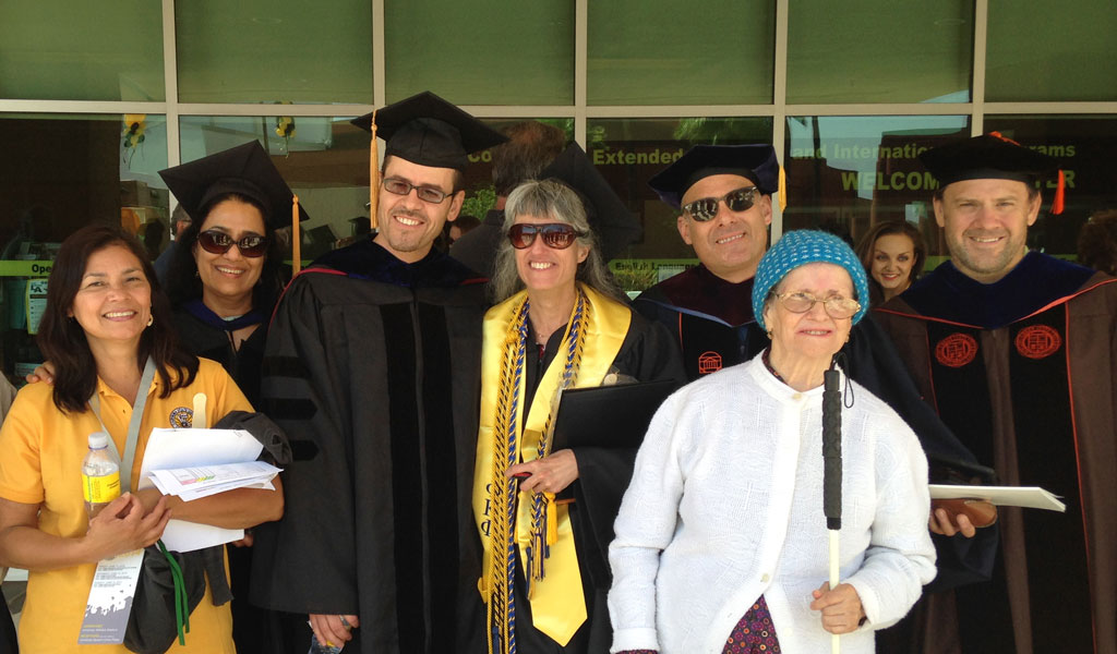 Department faculty and staff with summa cum laude graduate Linda Alviti