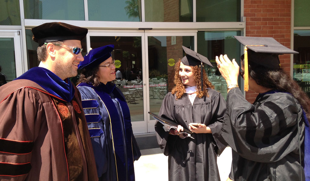 Professors Harris, Greenberg, and Chari with graduate Rosanna Cacace