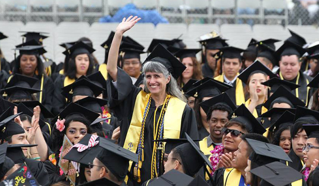English graduate Linda Alviti acknowledges praise from President Covino