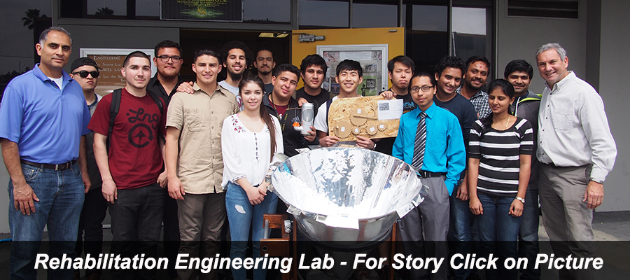 Rehab Engineering Lab - Students with The Solar Cone Water Boiler in Heated Action