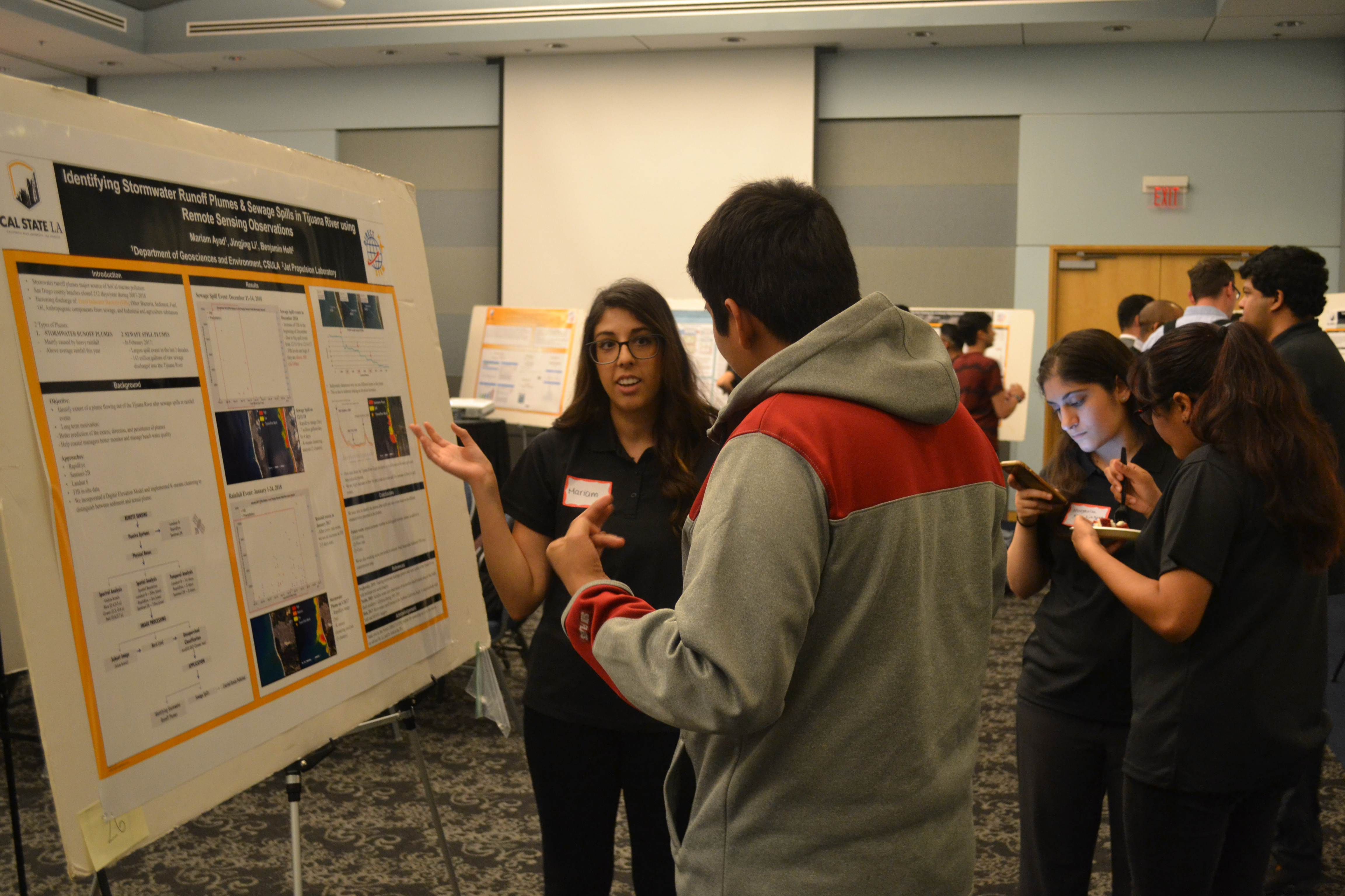 Mariam Ayad explaining her research poster at the 4th Annual NASA DIRECT-STEM Research Symposium