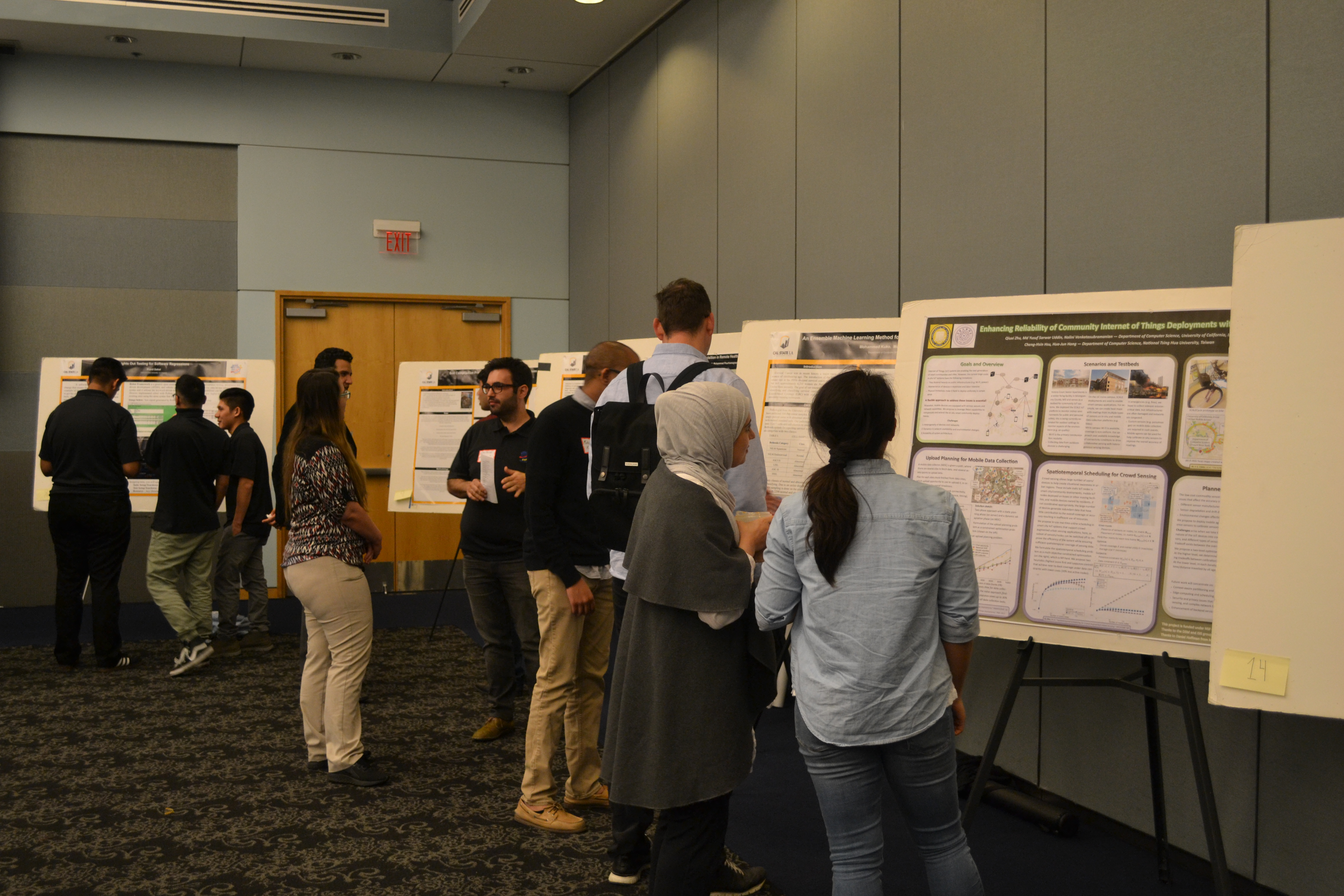 Students explaining their research posters at the 4th Annual NASA DIRECT-STEM Research Symposium