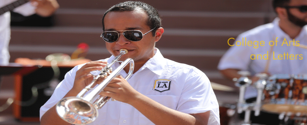 College Student wearing a white shirt with Cal State LA logo playing trumpet