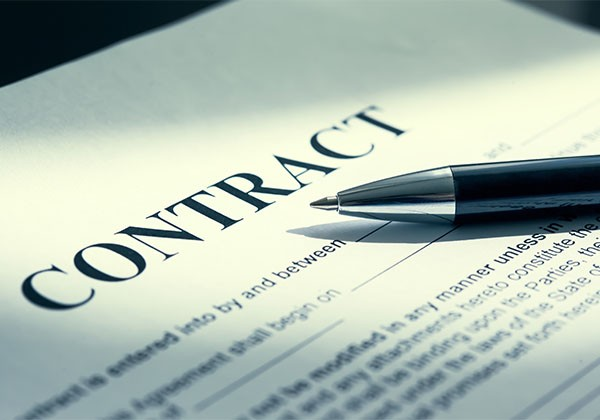 paper contract with pen