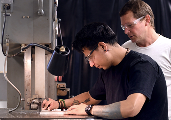 faculty helps student machining