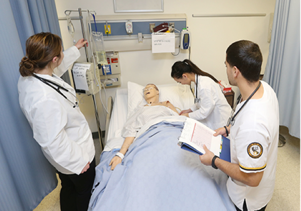 Nursing students working in the simulation lab.