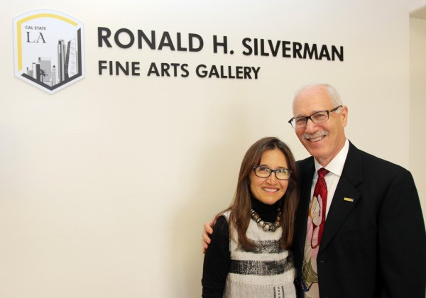 Two people standing in front of Ronald H. Silverman Fine Arts Gallery
