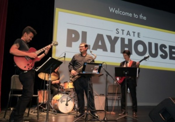 Three musicians playing at the State Playhouse