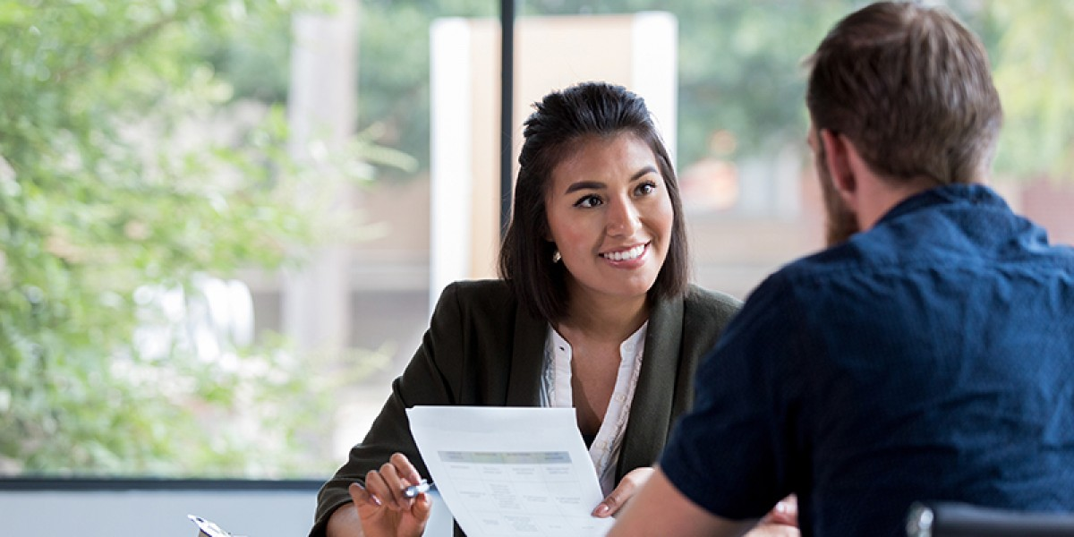 Image of Business Woman Interviewing an Applicant