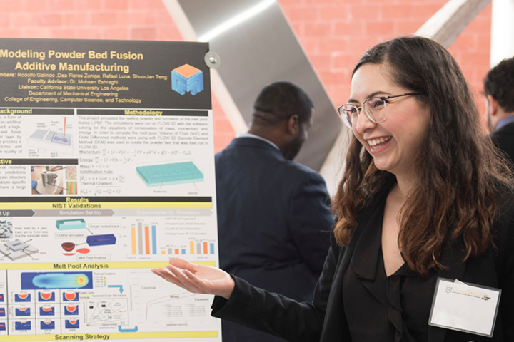 female student presents project poster at expo