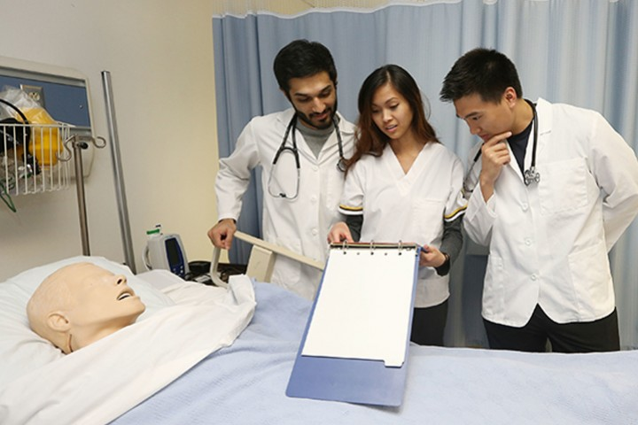 Photo of Nursing Students in Hospital Room Lab Setting