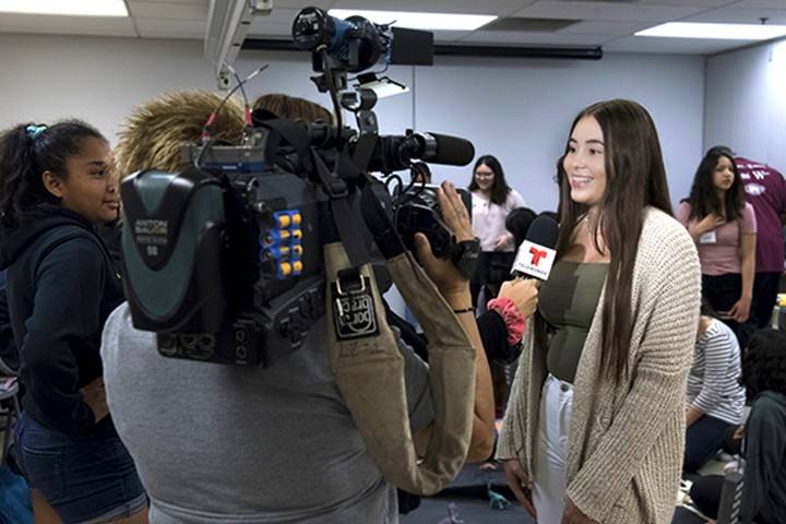 girl being interviewed on camera