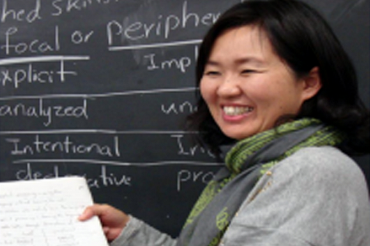 Student Smiling and Teaching