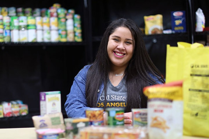 Smiling student in food pantry