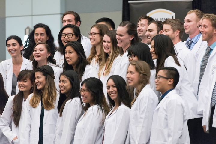 Nursing students at a white coat ceremony.