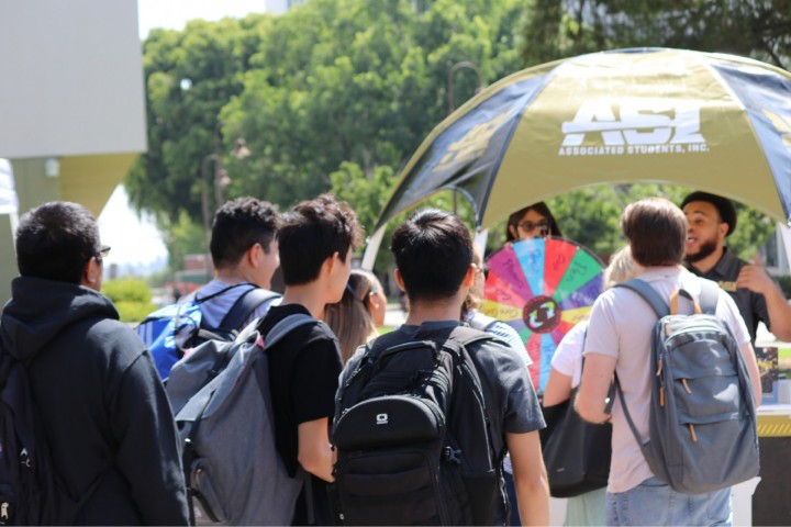 Students gathering around an ASI booth