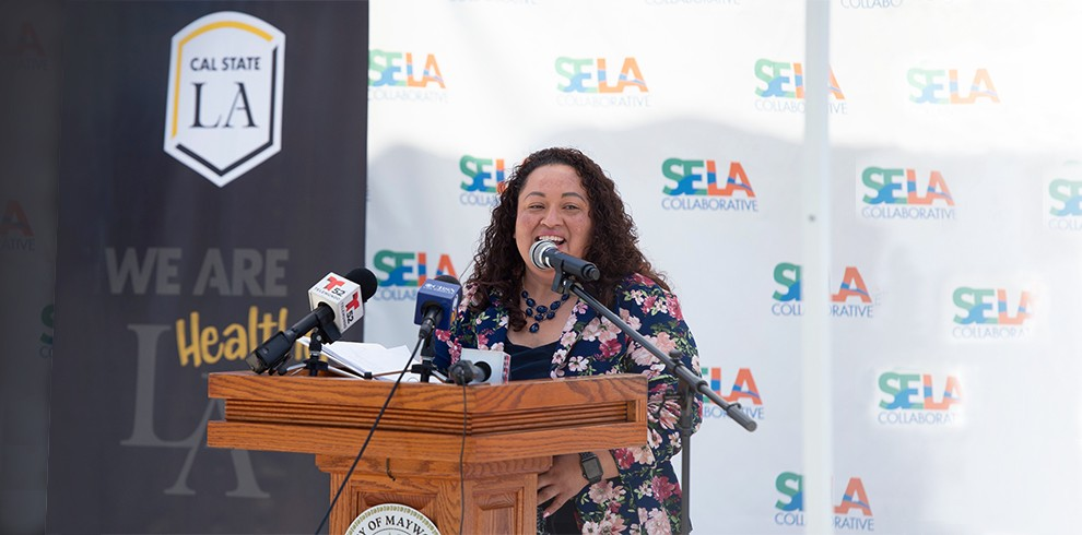 SELA Collaborative Executive Director Wilma Franco speaks at lectern