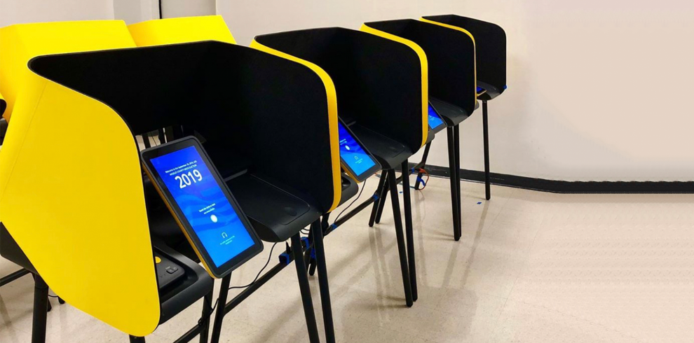 New voting machines in gold and blue with a tablet display that reads 2020