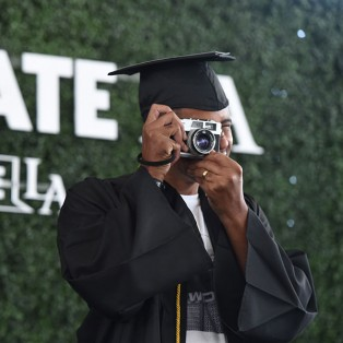 Graduate talking a picture onstage