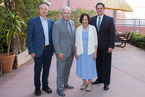 Howard Xu, William A. Covino, Jill Adler-Moore and Jose A. Gomez standing outside