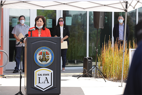 Supervisor Hilda L. Solis speaks at a lectern during the news conference