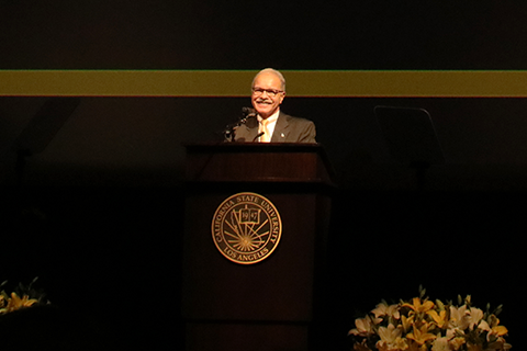 President Covino speaks at lectern at Convocation