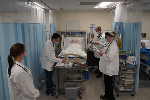 Four Cal State LA students in the nursing simulation lab.