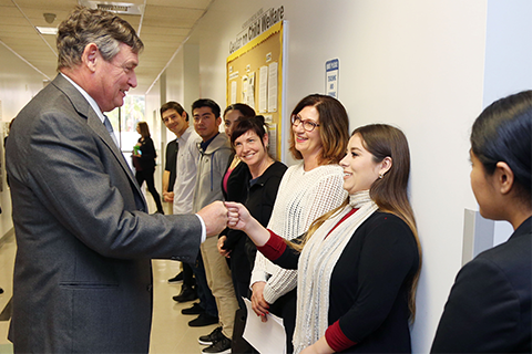 CSU Chancellor Timothy P. White and Cal State LA students.